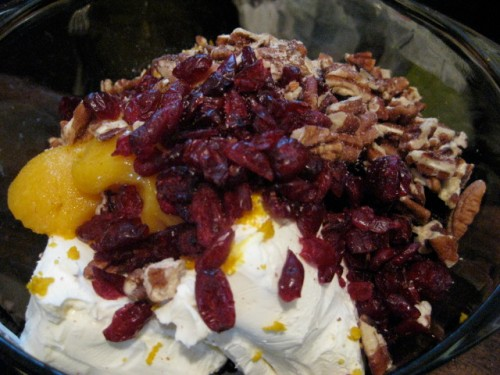 cream cheese, craisins, orange juice concentrate, orange zest, pecans, cinnamon