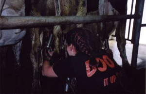bonding with new friends via milking apparatus, circa 2004